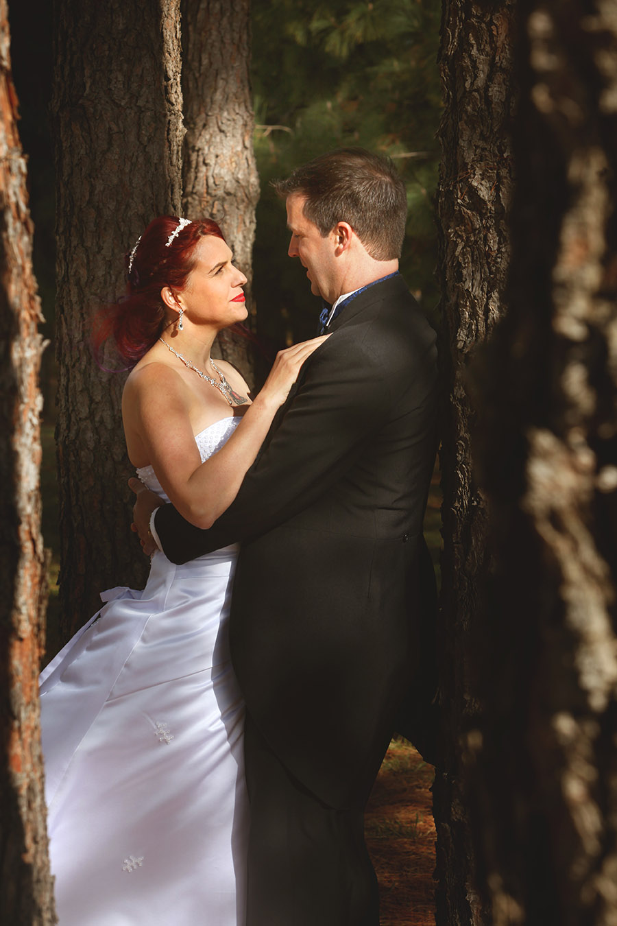 Beautiful black and white bridal gown photographer. Murwillumbah based photographer covering wedding in ACT Canberra, photographed in the woods. Bride in the woods. Gazing into eyes of groom