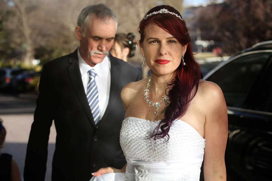 Bride exiting audi S7. Looking at camera with father of the Bride. Canberra ACT. Chris Gentle Wedding photography available to travel