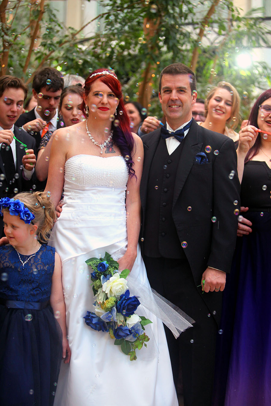 Wedding celebration with bubble blowing. Canberra wedding bride groom covered in bubbles