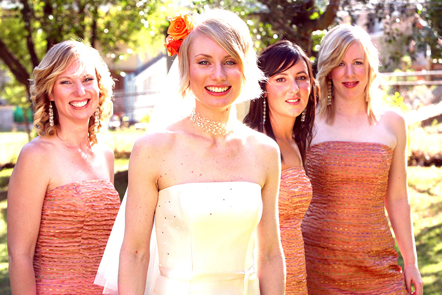 Bridal party at Camp Hill - Brisbane. Bride posing with bridesmaids. Gold Photographer covering weddings from Byrona Bay to Gold Coast, available to travel beyond.